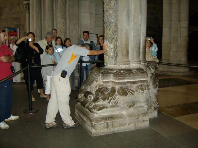 Traditional touching of the Portico in the Cathedral signaling the end of the journey